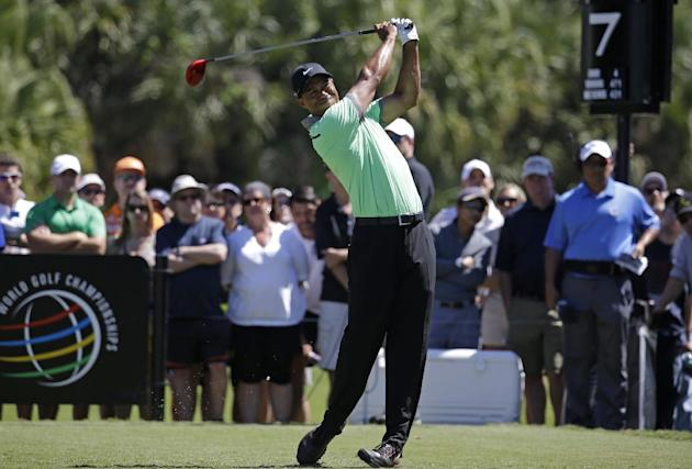 Tiger Woods hits from the seventh tee during the third round of the Cadillac Championship golf tournament Saturday, March 8, 2014, in Doral, Fla. (AP Photo/Lynne Sladky)