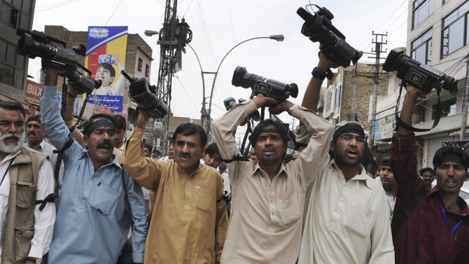 In this Tuesday, April 17, 2012 photo, Pakistani journalists chant slogans during a demonstation in Quetta, Pakistan. The telephone call to local journalists generally comes in the late evening. The voice on the other end is usually a Sunni militant with a statement he wants printed threatening of violence or claiming responsibility for attacks that already occurred. Journalists fear being killed if they don't print the messages.  (AP Photo/Arshad Butt)