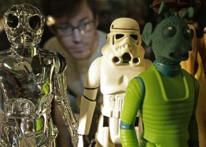 Employee Simon Domoney poses with Star Wars figures at the Forbidden Planet memorabilia and comic store in London
