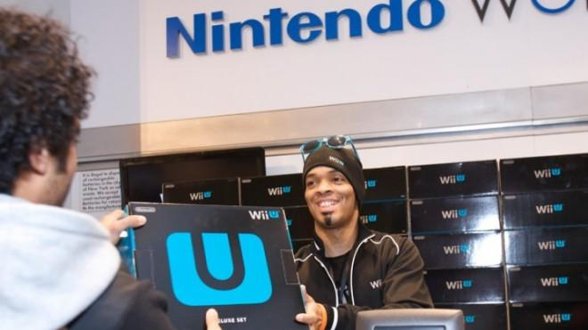A man snaps up one of the first available Wii U systems at a midnight launch party in New York on Nov. 18.