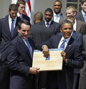 FILE - In this May 27, 2010 file photo, President Barack Obama looks over the bracket with coach Mike Krzyzewski of the NCAA basketball champion Duke Blue Devils in the Rose Garden of the White House in Washington, where he honored the team. The odds of completing the perfect bracket by picking the higher-seeded team are 35 billion to 1.  (AP Photo/Alex Brandon, File)