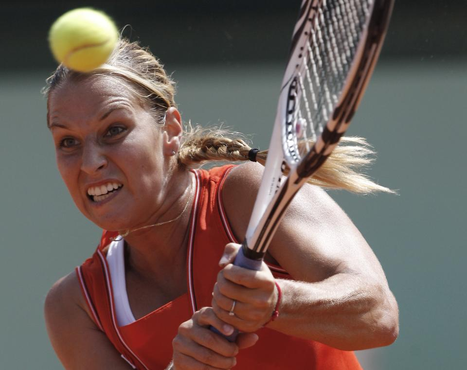 Slovakia's Dominika Cibulkova returns the ball to Australia's Samantha Stosur during their quarterfinal match in the French Open tennis tournament at the Roland Garros stadium in Paris, Tuesday, June 5, 2012. Stosur won 6-4, 6-1. (AP Photo/Michel Spingler)