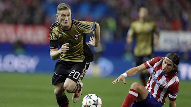 AC Milan's Ignazio Abate runs with the ball during a Champions League, round of 16, second leg, soccer match between Atletico Madrid and AC Milan at the Vicente Calderon stadium in Madrid, Tuesday March 11, 2014