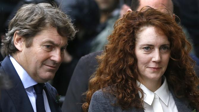 Rebekah Brooks and her husband Charlie Brooks arrive at The Old Bailey law court in London, Thursday, Oct. 31, 2013. Former News of the World national newspaper editors Rebekah Brooks and Andy Coulson went on trial Monday, along with several others, on charges relating to the hacking of phones and bribing officials while they were employed at the now closed tabloid paper. (AP Photo/Kirsty Wigglesworth)