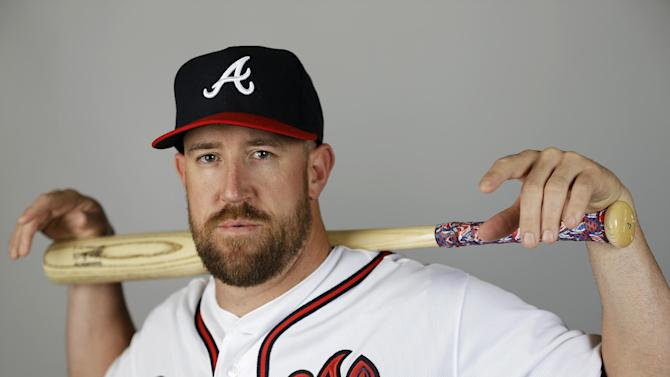 FILE - This March 2, 2015, file photo showing John Buck of the Atlanta Braves baseball team. Buck, an 11-year major league veteran who was attempting to land a job with the Atlanta Braves as a backup catcher, retired Thursday, March 26, 2015. (AP Photo/David Goldman, File)