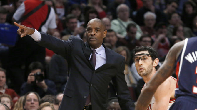 Atlanta Hawks coach Larry Drew gestures as Chicago Bulls guard Kirk Hinrich advances the ball during the second half of an NBA basketball game Monday, Jan. 14, 2013, in Chicago. The Bulls won 97-58. (AP Photo/Charles Rex Arbogast)