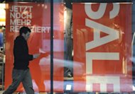 A man walks past a storefront advertising sales in Berlin, January 2010. Eurozone retail sales slipped by 0.2 percent in July from the previous month, preliminary data released by the EU statistics unit Eurostat showed, after a slight rise of 0.1 percent in June
