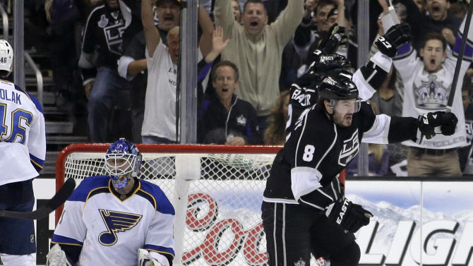 Los Angeles Kings defenseman Drew Doughty, right, celebrates his goal past St. Louis Blues goalie Brian Elliott during the first period in Game 6 of a first-round NHL hockey Stanley Cup playoff series in Los Angeles, Friday, May 10, 2013. (AP Photo/Jae C. Hong)