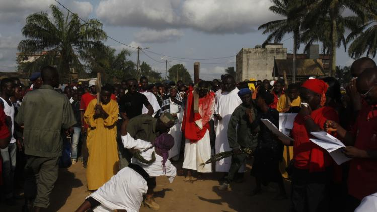 "Actors perform in a re-enactment of ""Via Crucis"" (Way of the Cross) during Holy Week at Abobote"