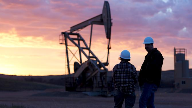 An oil well is pictured at sunrise in the Bakken oil fields near Sidney, Montana in this handout photo