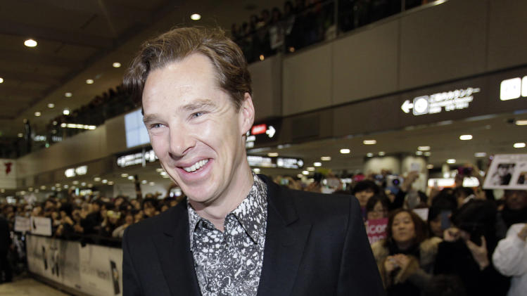 "FILE - In this Monday, Dec. 3, 2012 file photo, actor Benedict Cumberbatch smiles upon arrival at Narita international airport in Narita, east of Tokyo. Cumberbatch visited Japan to promote his latest film ""Star Trek Into Darkness."" Benedict Cumberbatch has had a busy 24 hours. The British actor was nominated for a Golden Globe for ""Sherlock"" on Thursday, Dec. 13, 2012, and unveiled the first 9 minutes of the new ""Star Trek"" movie. Speaking in London at a special presentation of the footage on Friday, Cumberbatch's character John Harrison is introduced at the start of the much-anticipated sci-fi sequel, ""Star Trek Into Darkness."" (AP Photo/Shizuo Kambayashi, File)"