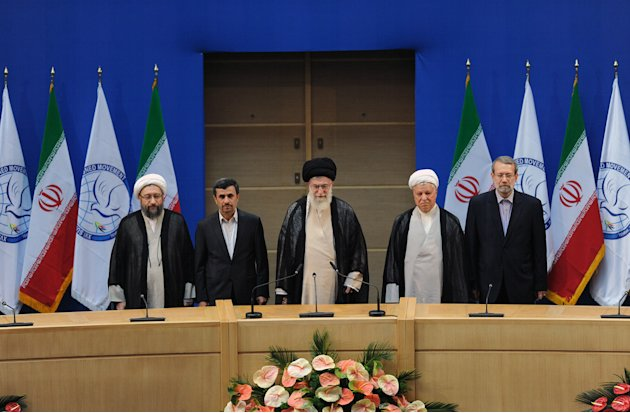 In this photo released by the official website of the Iranian supreme leader's office, supreme leader Ayatollah Ali Khamenei, center, parliament speaker Ali Larijani, right, chief of Expediency Counci