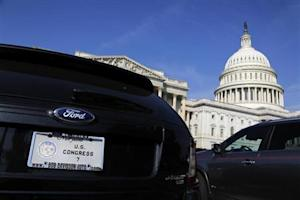 The cars of members of Congress fill the parking lot outside the House of Representatives during a Saturday session at the U.S. Capitol in Washington