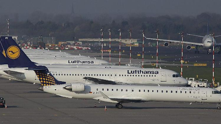 Lufthansa Airplanes are parked during a warning strike of employees of the German airliner Lufthansa in Duesseldorf, Germany, Monday, April 22, 2013.(AP Photo/Frank Augstein)