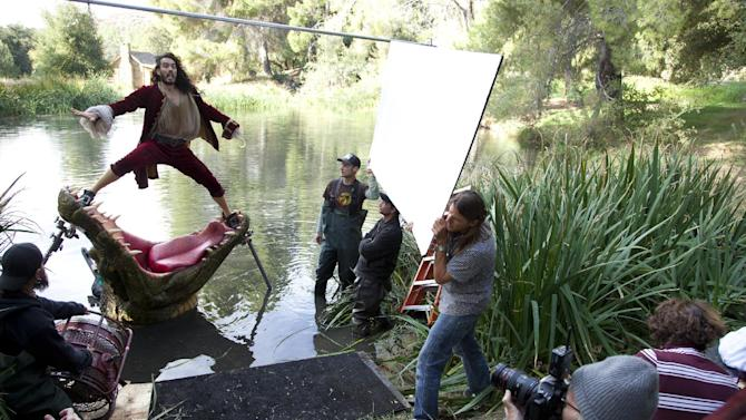 """This Nov. 3, 2011 photo released by Disney on Aug. 1, 2012 shows British actor Russell Brand dressed as Captain Hook from """"Peter Pan"""" during a photo shoot with photographer Annie Leibovitz, right, for the Disney Dream Portrait series near Newhall, Calif. The portrait series features celebrities set in Disney fantasy settings. The images by Leibovitz will be used as a special insert in fall issues of """"GQ,"""" """"O – The Oprah Magazine,"""" """"People,"""" """"People En Español,"""" """"Vanity Fair,"""" """"Real Simple,""""  """"Essence,"""" and """"InStyle,"""" to promote Disney theme parks. (AP Photo/Disney Parks.com, Scott Brinegar)"""