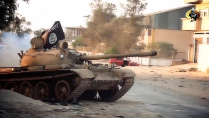 An image from a video made available on October 9, 2014, by the official media outlet of Benghazi-based Islamist Ansar al-Sharia group, al-Raya Media Foundation, allegedly shows a tank belonging to the group during a battle in Benghazi, Libya