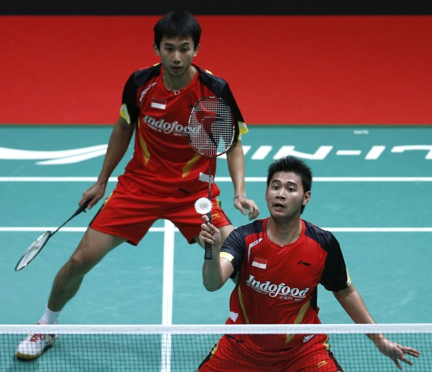 Indonesia's Pratama Angga with partner Saputro Rian Agung plays a shot during their men's doubles match against China's Fu Haifeng and Cai Yun in Kuala Lumpur