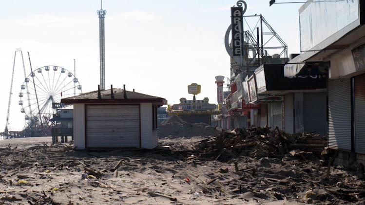 In this Nov. 29, 2012 photo, sand and rubble sit where the boardwalk used to be in Seaside Heights N.J. Seaside Heights, like many other coastal towns, is racing to rebuild its boardwalk from Superstorm Sandy's damage in time for next summer's tourism season. (AP Photo/Wayne Parry)