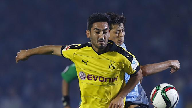 Borussia Dortmund's Guendogan fights for the ball against Kawasaki Frontale's Taniguchi during their friendly soccer match as part of Borussia Dortmund's Asia Tour in Kawasaki