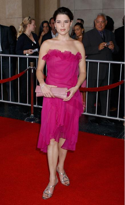 Neve Campbell in hot pink