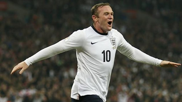 England's Wayne Rooney (C) celebrates after scoring during their 2014 World Cup qualifying soccer match against Poland at Wembley Stadium in London October 15, 2013. REUTERS