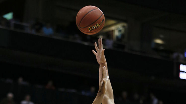 Arizona's Kaleb Tarczewski, right, shoots over Belmont's Blake Jenkins during the first half of a second-round game in the NCAA college basketball tournament in Salt Lake City Thursday, March 21, 2013. (AP Photo/George Frey)