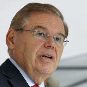 """FILE - This Sept. 27, 2012 file photo shows Sen. Robert Menendez, D-N.J. speaking in Sayreville, N.J.  Federal immigration agents were prepared to arrest an illegal immigrant and registered sex offender days before the November elections but were ordered by Washington to hold off after officials warned of """"significant interest"""" from Congress and news organizations because the suspect was a volunteer intern for Menendez, according to internal agency documents provided to Congress. (AP Photo/Mel Evans, File)"""