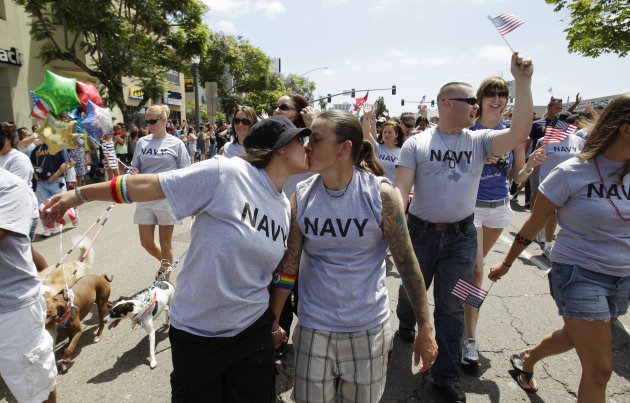 FILE - In this July 16, 2011 file photo, two women, both active duty sailors in the Navy who gave their names as Nikki, left, and Lisa, kiss as they march in the Gay Pride Parade in San Diego. The Defense Department on Thursday, July 19, 2012 announced it is allowing service members to march in uniform in a gay pride parade for the first time in U.S. history. The department said it was making the exception for Saturday&#39;s San Diego Gay Pride Parade because organizers had encouraged military personnel to march in their uniform and the event was getting national attention. (AP Photo/Gregory Bull, File)
