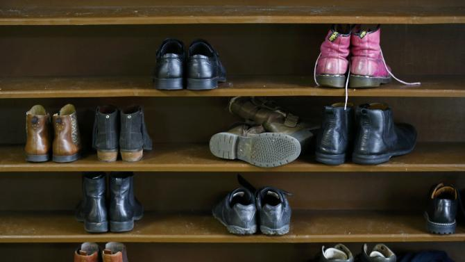 Shoes belonging to visitors stand in a rack as they are given a tour of the Birmingham Central Mosque