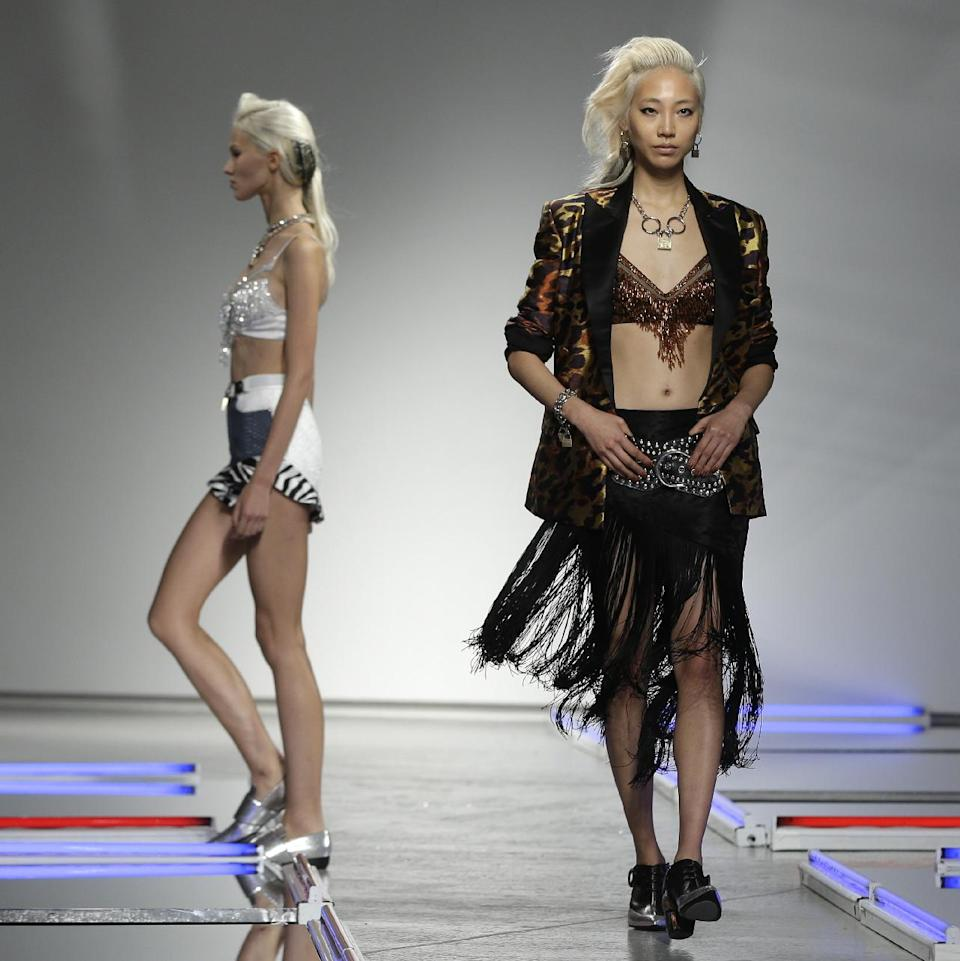 The Rodarte Spring 2014 collection is modeled during Fashion Week in New York, Tuesday, Sept. 10, 2013. (AP Photo/Seth Wenig)