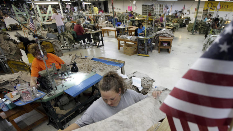 FILE - In this Wednesday, Oct. 10, 2012 file photo, apparel worker Misti Keeton sews military apparel in Fayette, Ala. The government reports on worker productivity and labor costs in the October-December quarter of 2012, on Thursday, Feb. 7, 2013. (AP Photo/Dave Martin, File)