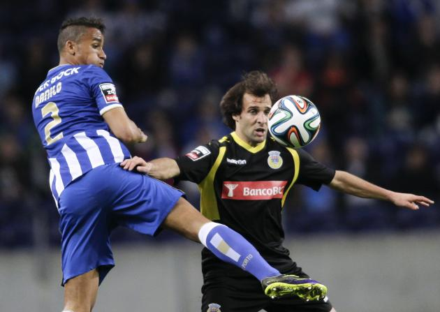 Porto's Danilo battles for the ball with Arouca's Pintassilgo during their Portuguese Premier League soccer match in Porto