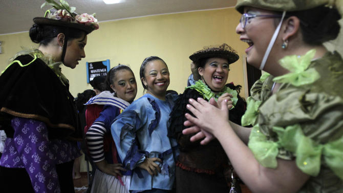 """In this Sept. 21, 2012 photo, cast members pose for a photo backstage prior to their performance in """"Suenos,"""" or """"Dreams,"""" one of Ecuador's most successful musicals, at the Casa de la Cultura theater in Quito, Ecuador. The musical is based in part on the dreams of young people with disabilities and is presented by the nonprofit foundation El Triangulo. (AP Photo/Dolores Ochoa)"""