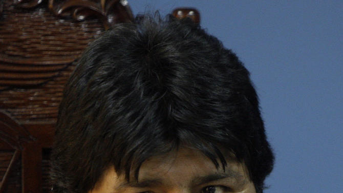 Bolivia's President Evo Morales gestures during a meeting with Peru's President Alan Garcia, unseen, in the port of Ilo, southern Peru, Tuesday, Oct. 19, 2010. Morales is on a one-day official visit to Peru. (AP Photo/Karel Navarro)