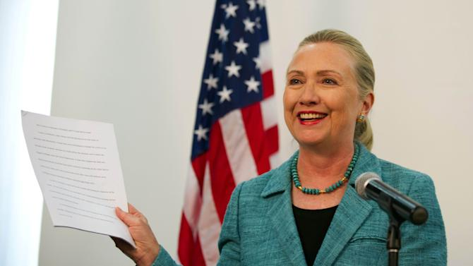 """U.S. Secretary of State Hillary Rodham Clinton shows paperwork as she refers to the """"As Prepared"""" version of former President Bill Clinton's Democratic National Convention speech that she had read during a joint press conference with East Timor Prime Minister Xanana Gusmao at the Government Palace in Dili, East Timor, Thursday, Sept. 6, 2012. Clinton is in East Timor to offer the small half-island nation support as it ends its reliance on international peacekeepers. (AP Photo/Jim Watson, Pool)"""