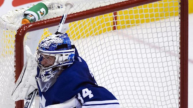 Toronto Maple Leafs goalie James Reimer looks on after being scored on against the Boston Bruins during the second period of Game 4 of their NHL hockey Stanley Cup playoff series, Wednesday, May 8, 2013, in Toronto. (AP Photo/The Canadian Press, Nathan Denette)