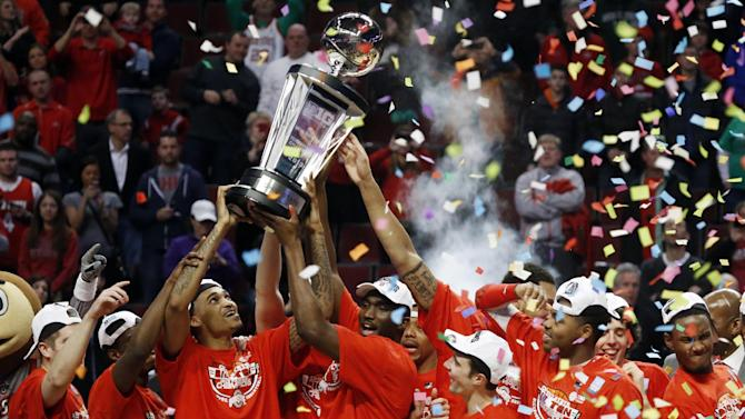 Ohio State players celebrate after winning an NCAA college basketball game against Wisconsin in the championship of the Big Ten tournament Sunday, March 17, 2013, in Chicago. Ohio State won 50-43. (AP Photo/Charles Rex Arbogast)