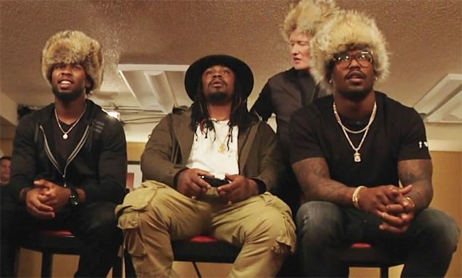 Von Miller, Josh Norman, And Marshawn Lynch Enter 'Doom' On The Super Bowl Edition Of 'Clueless Gamer'
