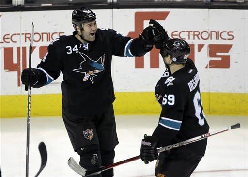 Sharks boost playoff hopes, beating Bruins 2-1