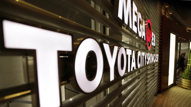 In this Dec. 27, 2012 photo, a man walks out from a Toyota showroom in Tokyo. Now it's official: Toyota is once again the world's top automaker. Toyota Motor Corp. released its tally for global vehicle sales for last year Monday, Jan. 28, 2013 at a record 9.748 million vehicles — a bigger number than the estimate it gave last month of about 9.7 million vehicles. (AP Photo/Shizuo Kambayashi)