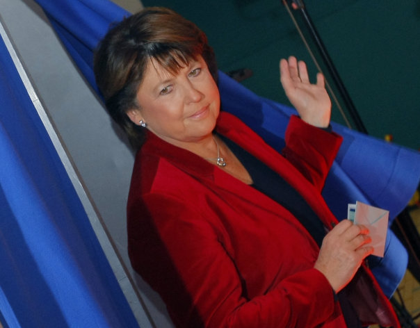 French Socialist Party secretary general Martine Aubry, leaves a polling booth before voting for the second round of primary elections of the Socialist Party in Lille, northern France, Sunday Oct, 16, 2011. (AP Photo/Michel Spingler)