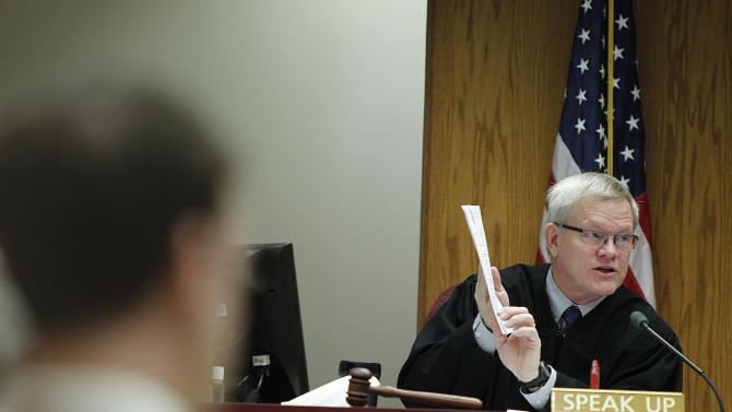 Judge Howard Cameron gives the jury instructions after they were given the Aaron Schaffhausen case in a St. Croix County Courtroom in Hudson, Wis., Tuesday, April 16, 2013. A jury on Tuesday rejected an insanity defense by Schaffhausen, a Wisconsin father who admitted killing his three young daughters last July, ruling that he had a mental defect but still understood that what he was doing was wrong. (AP Photo/The Star Tribune, Elizabeth Flores)