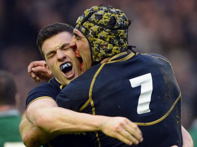 Scotland's Scott and Brown celebrate their victory against Ireland following their Six Nations rugby match at Murrayfield Stadium in Edinburgh