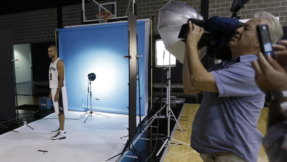 San Antonio Spurs' Tony Parker, of France, poses for a photo at the team's workout facility during their NBA basketball media day, Monday, Sept. 30, 2013, in San Antonio. (AP Photo/Eric Gay)