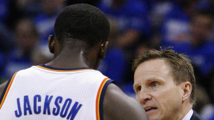 Oklahoma City Thunder head coach Scott Brooks coaches Reggie Jackson during the second quarter of Game 1 of their Western Conference Semifinals NBA basketball playoff series in Oklahoma City, Sunday, May 5, 2013.  (AP Photo/Alonzo Adams)