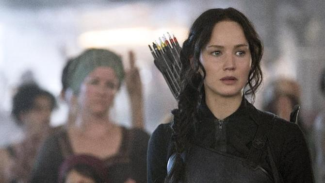 """In this image released by Lionsgate, Jennifer Lawrence portrays Katniss Everdeen in a scene from """"The Hunger Games: Mockingjay Part 1."""" (AP Photo/Lionsgate, Murray Close)"""
