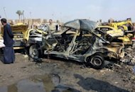 A destroyed car lies at the scene of a explosion at the bird market in the Baghdad neighbourhood of Kadhimiyah, on February 8, 2013. A spate of car bombs in Shiite areas of Iraq, including two blasts minutes apart at a popular bird market, killed at least 33 people, the latest spike in violence amid a simmering political crisis