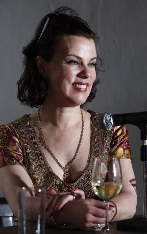 """Actress and food blogger Debi Mazar laughs during a panel discussion called """"Girls Gone Wild"""" about women in the celebrity cooking world at the South Beach Wine and Food Festival, Saturday, Feb. 25, 2012 in Miami.  (AP Photo/Carlo Allegri)"""