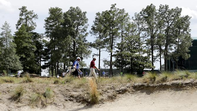 Retief Goosen, of South Africa, walks to the 18th green during a practice round for the U.S. Open golf tournament in Pinehurst, N.C., Monday, June 9, 2014. The tournament starts Thursday. (AP Photo/Chuck Burton)