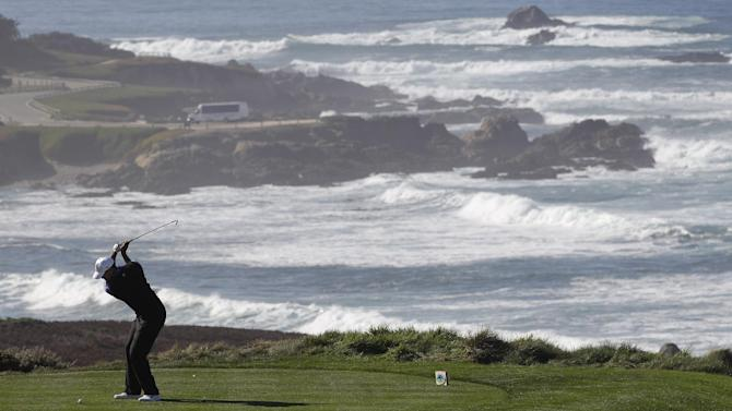 Tiger Woods hits from the fourth tee at Spyglass Hill Golf Course during the first round of the Pebble Beach National Pro-Am golf tournament in Pebble Beach, Calif., Thursday, Feb. 9, 2012. (AP Photo/Marcio Jose Sanchez)